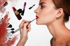 Beautiful female lips with make-up and brush Stock Images