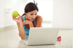 Beautiful female looking surprised a laptop Stock Images