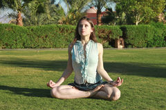 Beautiful female in the lotus position looking up Royalty Free Stock Photos