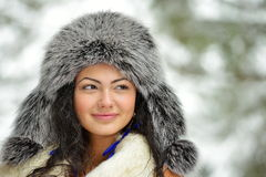 Beautiful female in luxurious fur head cloth outdoor in winter Royalty Free Stock Image