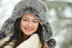 Beautiful female in luxurious fur head cloth outdoor in winter Stock Photo