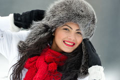 Beautiful female in luxurious fur head cloth outdoor in winter Royalty Free Stock Photos