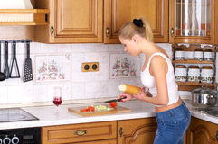 Beautiful female making sandwich at Stock Photo