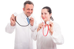 Beautiful female and male medic with their stethoscopes Royalty Free Stock Photography