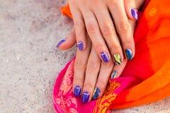 Beautiful female manicure on the sand Stock Photo