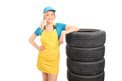 Beautiful female mechanic in a yellow uniform Royalty Free Stock Photography