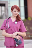 Beautiful female medical professional in scrubs outside Royalty Free Stock Photo