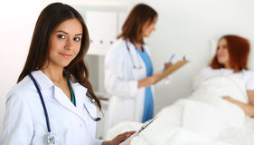 Beautiful female medicine doctor looking in camera Royalty Free Stock Images