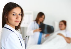 Beautiful female medicine doctor looking in camera Royalty Free Stock Photos