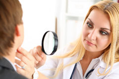 Beautiful female medicine doctor with serious face royalty free stock photography
