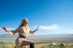 Fashionable woman outdoors. Fashionable blond woman posing with Great Salt Lake in the background, Utah, U.S.A Royalty Free Stock Image