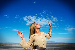 Beautiful female model against blue sky Royalty Free Stock Images