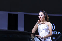 Beautiful female model in a car exhibition, China Royalty Free Stock Photo