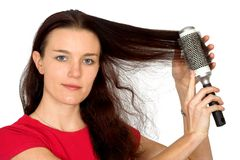 Beautiful female model combing her hair Stock Images