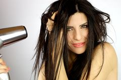 Beautiful female model drying long messy hair Royalty Free Stock Photos