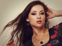 Beautiful female model in fashion necklace Stock Photography