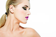 Beautiful female model with full makeup. Royalty Free Stock Photo