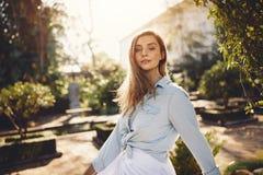 Beautiful female model at garden Royalty Free Stock Image