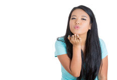 Beautiful female model in green sweater blowing kiss Royalty Free Stock Photos