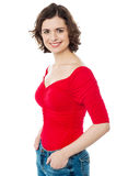 Beautiful female model with hands in jeans pocket Royalty Free Stock Photos