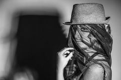 Beautiful female model with hat and veil on the face with shadow stock photos