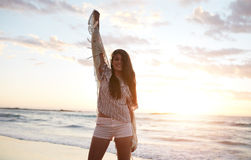 Beautiful female model having fun on the beach Royalty Free Stock Images