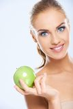 Beautiful female model holding an apple Royalty Free Stock Photography