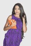 Beautiful female model holding tab computer studio white gray background Royalty Free Stock Photo