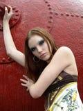 Beautiful female model in an industrial ar Stock Photos