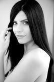 Beautiful female model with long black hair smiling Royalty Free Stock Photography