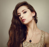 Beautiful female model with long hair posing Stock Images