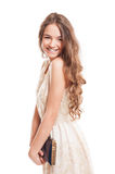 Beautiful female model with long natural hair smiling Stock Image
