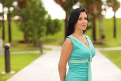 Beautiful female model in the park Stock Photography