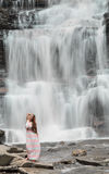 Beautiful female model posing in front of waterfall Royalty Free Stock Photos