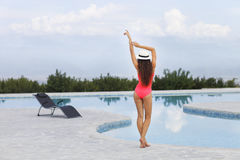 Beautiful female model posing by the outdoor pool Royalty Free Stock Image