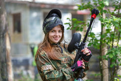 Beautiful female model posing in paintball ammunition outdoors Royalty Free Stock Photo