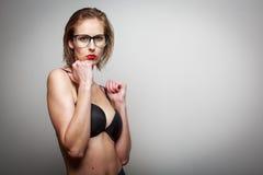 Beautiful female model posing in a photographic studio Stock Photo