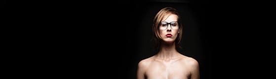Beautiful female model posing in a photographic studio Stock Image