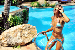 Beautiful female model posing by the pool, outdoor portrait Stock Image