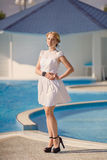Beautiful female model posing by the pool Royalty Free Stock Photography