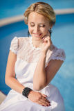 Beautiful female model posing by the pool Stock Image