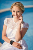 Beautiful female model posing by the pool Royalty Free Stock Photo