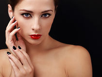 Beautiful female model with red lipstick and black nails polish looking Stock Photo