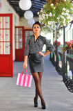 Beautiful female model with shopping bag. Full length portrait.  Royalty Free Stock Photo