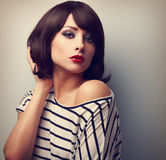 Beautiful female model with short hair style in casual dress. Vi Stock Photos