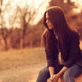 Beautiful female model at sunset. Wearing sunglasses. Outdoor po Stock Image
