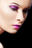 Beautiful female model, violet glitter eye-make-up Stock Images