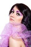 Beautiful female model with violet glitter eye-make-up Stock Images