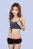 Beautiful female model wearing gray tank top Royalty Free Stock Images
