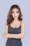 Beautiful female model wearing gray tank top